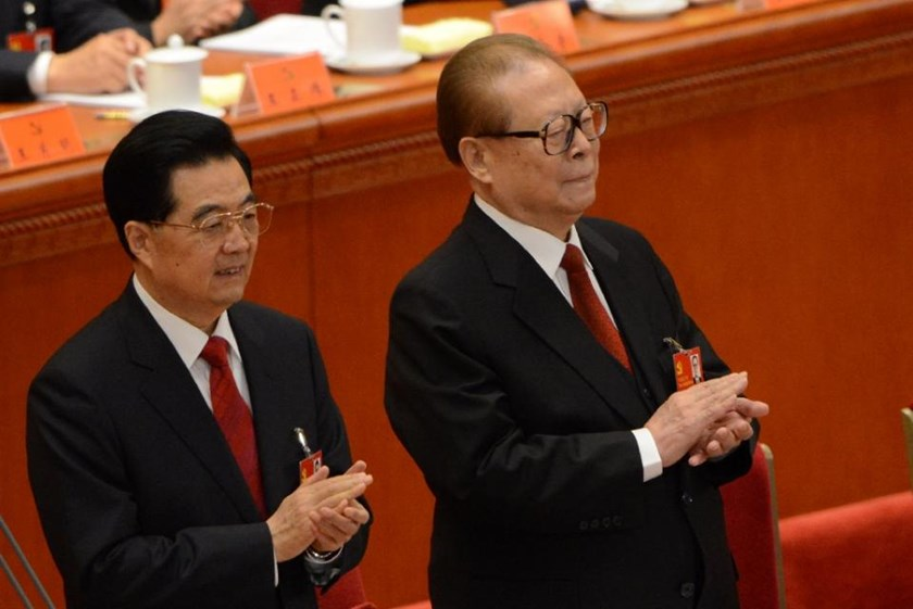 China's former security czar Zhou Yongkang, who was sentenced to life in jail in June, is regarded as an ally of former president Jiang Zemin, right, but is also believed to have retained significant power when Hu Jintao, left, was in power