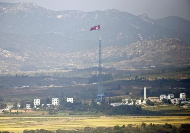 A North Korean flag is seen on top of a tower near the truce village of Panmunjom in the demilitarised zone (DMZ) separating North Korea from South Korea, about 55 km (34 miles) north of Seoul, September 25, 2013.