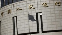 A fluttering Chinese national flag casts its shadow on the headquarters of the People's Bank of China, China's central bank, in central Beijing November 24, 2014.