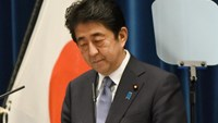 Japanese Prime Minister Shinzo Abe looks down as he delivers a war anniversary statement that neighbouring nations will scrutinise for signs of sufficient remorse over Tokyo's past militarism