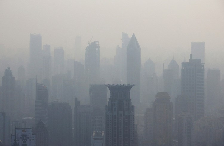 Commercial and residential buildings stand shrouded in haze in Shanghai, China, on April 18. Photo: Bloomberg