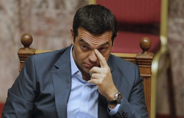 Greek Prime Minister Alexis Tsipras reacts as he attends a parliamentary session in Athens, Greece, August 14, 2015.