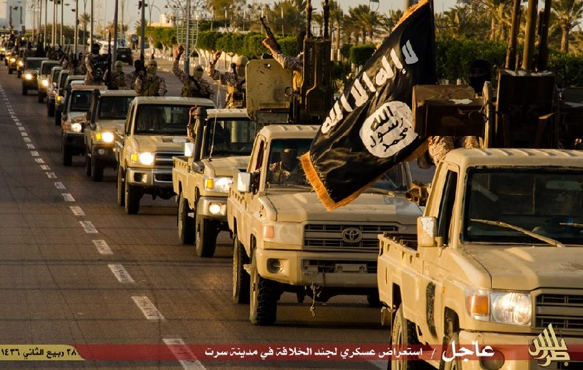 An image made available by propaganda Islamist media outlet Welayat Tarablos in February 2015, allegedly shows members of the Islamic State (IS) militant group parading in a street in Libya's coastal city of Sirte