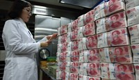 China reserves seen dropping $40 billion a month on yuan support