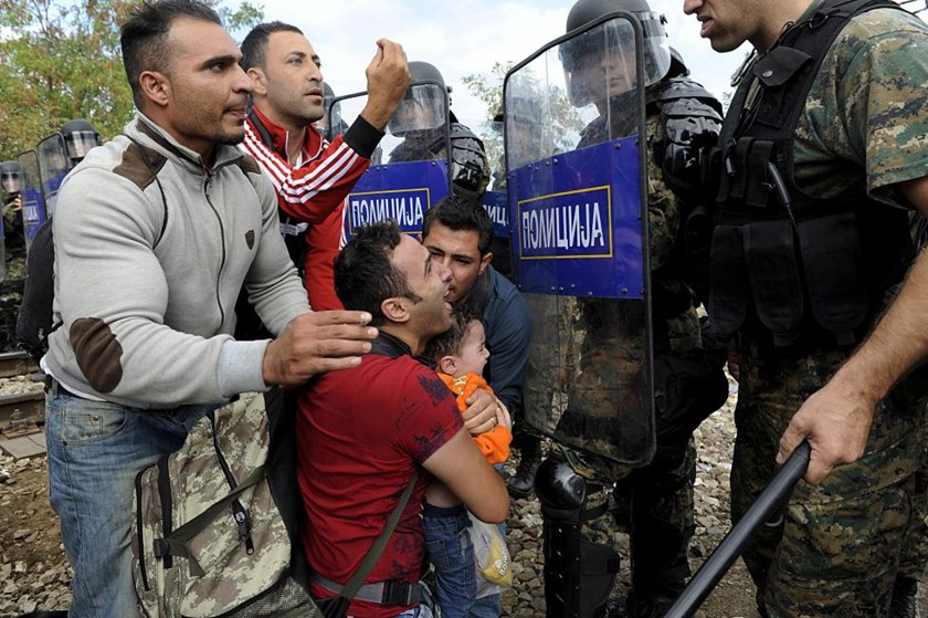 Migrants confront Macedonian police during clashes at the Greek-Macedonian border, August 21, 2015.