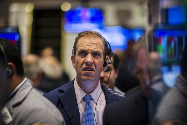 A trader works on the floor of the New York Stock Exchange shortly after the opening bell in New York, August 18, 2015.