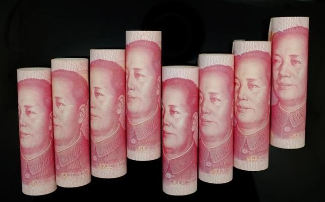 100 Yuan notes are seen in this illustration picture in Beijing November 5, 2013.