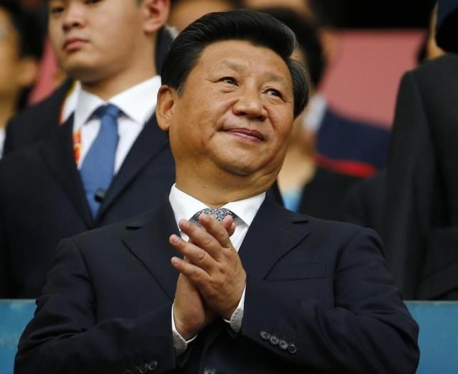Chinese President Xi Jinping applauds during the opening ceremony of the 15th IAAF World Championships at the National Stadium in Beijing, China August 22, 2015.