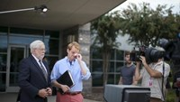 Chris Hurst (R), a journalist at the station and boyfriend of killed journalist Alison Parker pauses for a moment as Jeff Marks (L), general manager for WDBJ7 looks on as they speak with NBC's Today Show outside of the offices for WDBJ7 where killed journalists Alison Parker and Adam Ward worked in Roanoke, Virginia August 27, 2015.