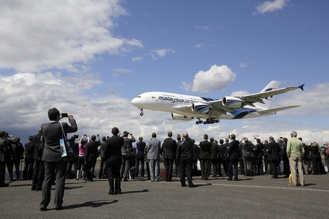 An Airbus A380 aircraft operated by Malaysia Airlines performs at the Farnborough International Airshow in 2012. Photo: Bloomberg
