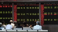 Investors look at screens showing stock market movements at a securities company in Beijing, China, on August 25, 2015