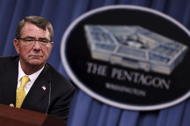 U.S. Defense Secretary Ash Carter listens to questions during a news conference at the Pentagon in Arlington, Virginia in this August 20, 2015 file photo.