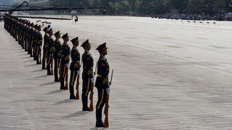 Chinese military officers stand in a line during a rehearsal ahead of military parade. Photographer: ChinaFotoPress via Getty Images