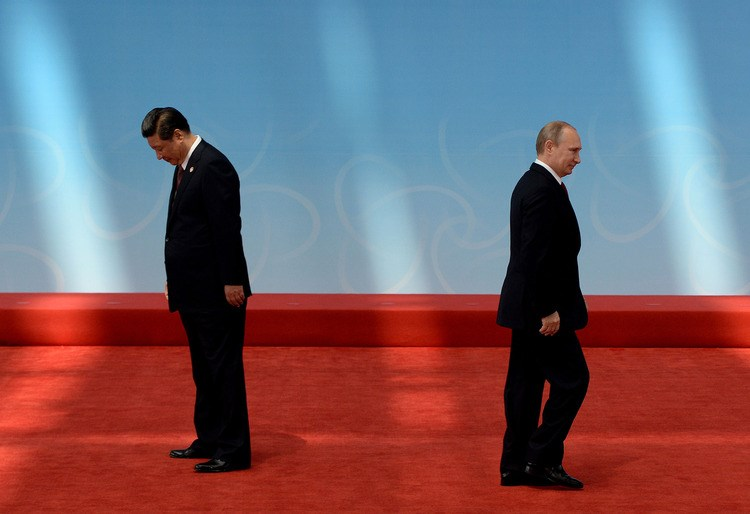 Russian President Vladimir Putin after being greeted by Chinese President Xi Jinping before the opening ceremony of the CICA summit in Shanghai on May 21, 2014. Photo: AFP