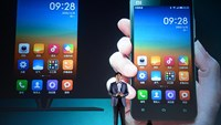 Lei Jun of Xiaomi celebrates the third anniversary of the phone's release in Beijing on April 9, 2013.
