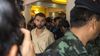 An arrested suspect of the recent Bangkok blast is detained by military personnel at the Metropolitan Police Bureau in central Bangkok, Thailand, September 4, 2015.
