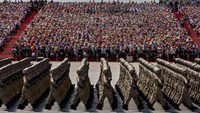 Chinese soldiers march in formation during the military parade in Beijing on Thursday. Photographer: Kevin Frayer/Getty Images