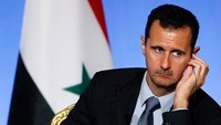 Syria's President Assad accepts early parliamentary elections, Putin says