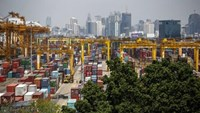 Shipping containers stand at a port in Bangkok March 30, 2015.