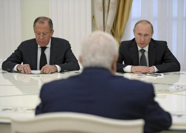Russian President Vladimir Putin (R), Foreign Minister Sergei Lavrov (L) and Syrian Foreign Minister Walid al-Muallem (back to camera) attend a meeting at the Kremlin in Moscow, Russia, June 29, 2015.
