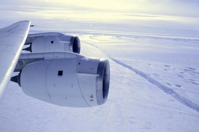 NASA's DC-8 flies across a crack, 18 miles (29 km) in length, forming across the Pine Island Glacier ice shelf in this October 26, 2011 handout photograph.