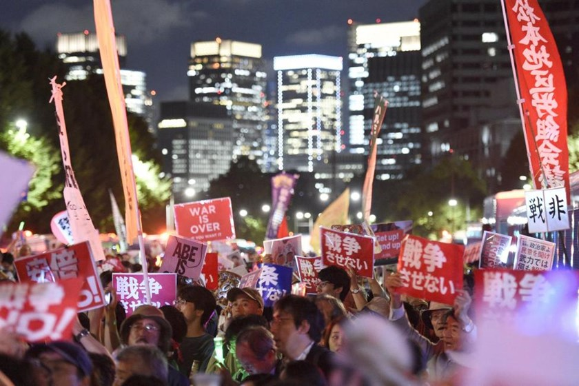 Protesters gather at a rally against Japan's Prime Minister Shinzo Abe's security bill and his administration in front of the parliament building in Tokyo, in this photo taken by Kyodo September 14, 2015. Mandatory credit