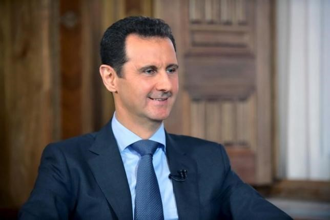 Syria's President Bashar al-Assad answers questions during an interview with al-Manar's journalist Amro Nassef, in Damascus, Syria, in this handout photograph released by Syria's national news agency SANA on August 25, 2015.