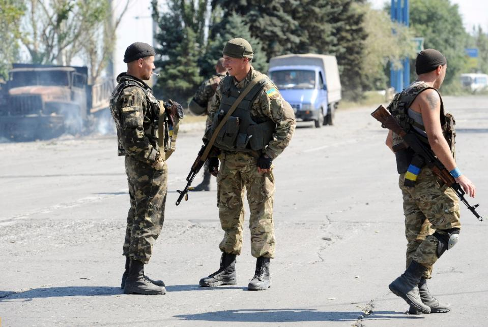 Shells silent, stressed Ukraine fighters face alcohol threat