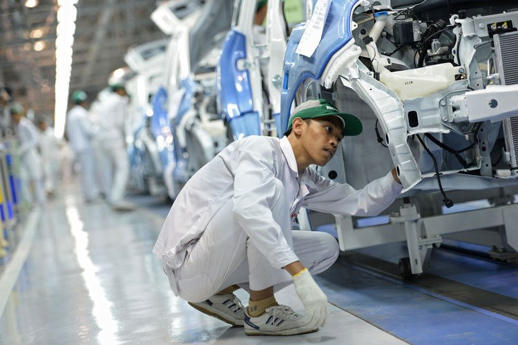 An employee assembles the Honda Motor Co. vehicle at the PT Honda Prospect Motor factory