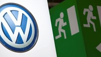 Volkswagen logo is seen next to an emergency exit sign on the company's booth during the first media day of the Geneva Auto Show at the Palexpo in Geneva, in this March 6, 2012 file photo.