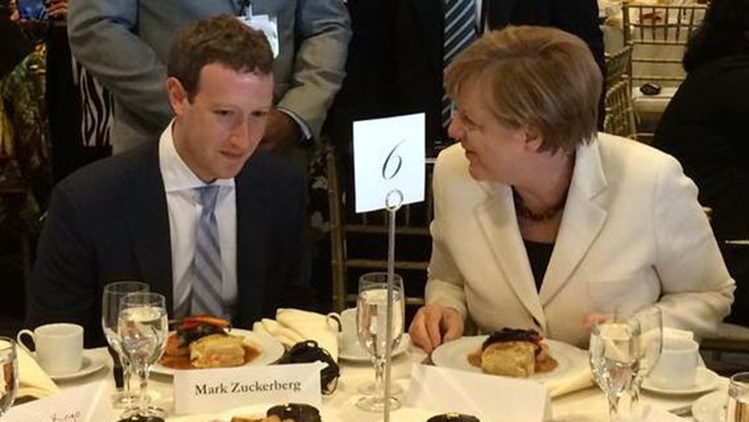 Germany's chancellor Angela Merkel speaks with Facebook Inc. co-founder and chief executive officer, Mark Zuckerberg, at a luncheon at the United Nations development summit. Photographer: Syed Mahmood Kazmi/@SMahmoodKazmi