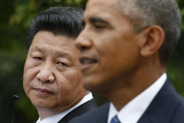 Chinese President Xi Jinping (L) listens to U.S. President Barack Obama during a joint news conference in the Rose Garden at the White House in Washington September 25, 2015.