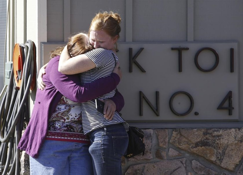 Umpqua Community College alumnus Donice Smith (L) is embraced after she said one of her former teachers was shot dead, near the site of a mass shooting at Umpqua Community College in Roseburg, Oregon, October 1, 2015.