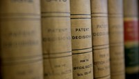 Volumes of patent decisions from the Official Gazette of the U.S. Patent and Trademark Office sit at the headquarters' public search facility in Alexandria, Virginia.