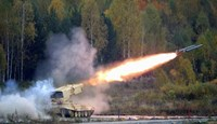 A Russian 'TOS-1 Buratino' multiple rocket launcher fires during the 'Russia Arms Expo 2013' 9th international exhibition of arms, military equipment and ammunition, in the Urals city of Nizhny Tagil, September 25, 2013.