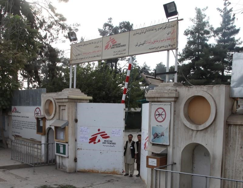 Afghan guards stand at the gate of Medecins Sans Frontieres (MSF) hospital after an air strike in the city of Kunduz, Afghanistan October 3, 2015.