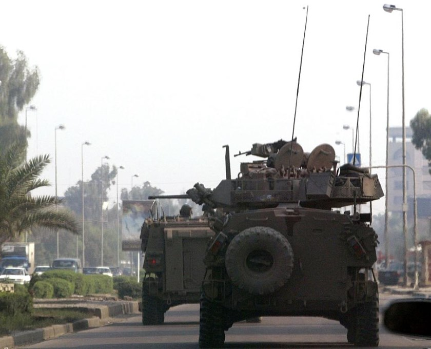 Australian armoured vehicles are seen on a busy street in Baghdad, in 2004