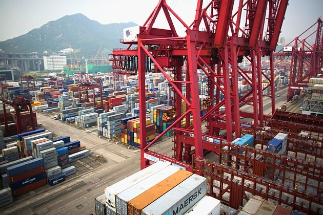 Shipping containers and cranes at the Modern Terminals container port in Hong Kong in a file photo