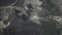 A frame grab taken from footage released by Russia's Defence Ministry October 4, 2015, shows what Russia says is smoke rising after airstrikes carried out by the Russian air force on the Islamic State near Jisr al-Shughour in Idlib province, Syria.