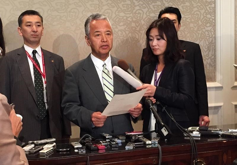 Japanese trade minister Akira Amari (centre) speaks to media during a break in the Trans-Pacific Partnership talks in Atlanta, Georgia October 3, 2015.