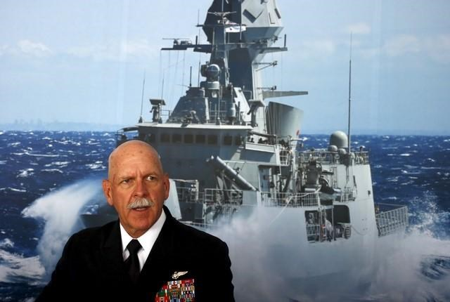 Commander of the U.S. Pacific Fleet Admiral Scott Swift sits in front of a large poster of an Australian Navy frigate as he speaks during a media conference at the 2015 Pacific International Maratime Exposition in Sydney, Australia, October 6, 2015.