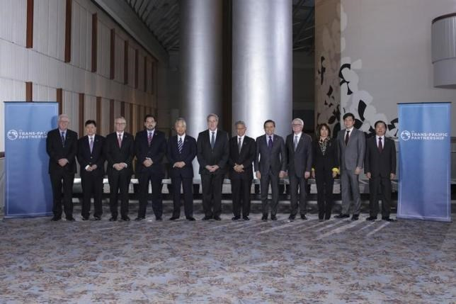 Trade ministers from a dozen Pacific nations in Trans-Pacific Partnership Ministers meeting post in TPP Ministers ''Family Photo'' in Atlanta, Georgia October 1, 2015.