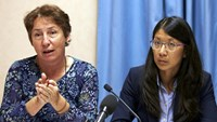 Francoise Saulnier, Medecins Sans Frontieres (MSF) legal counsel gestures next to Joanne Liu, President of MSF International, during a news conference in Geneva, Switzerland, October 7, 2015.