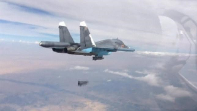 A frame grab taken from footage released by Russia's Defence Ministry October 9, 2015, shows a Russian Su-34 fighter-bomber dropping a bomb in the air over Syria.