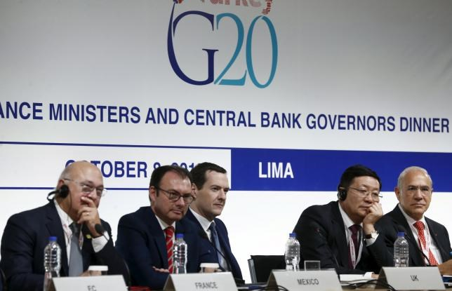 (L-R) French Finance Minister Michel Sapin, Mexico's Finance Minister Luis Videgaray, Britain's Chancellor of the Exchequer George Osborne, China's Finance Minister Lou Jiwei and Organisation for Economic Co-operation and Development (OECD) Secretary-General Angel Gurria attend a Finance Ministers and Central Bank Governors of the G20 group news conference at the 2015 IMF/World Bank Annual Meetings in Lima, Peru, October 9, 2015.