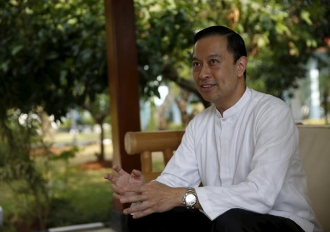 Indonesian Trade Minister Tom Lembong chats with members of the media during a visit to Rangkasbitung, Banten province, near Jakarta September 24, 2015.