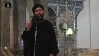 Abu Bakr al-Baghdadi at a mosque in the centre of Iraq's second city, Mosul, according to a video recording posted on the Internet on July 5, 2014, in this still image taken from video.