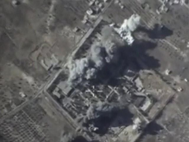 A frame grab taken from footage released by Russia's Defence Ministry October 12, 2015, shows what Russia says is smoke rising after air strikes carried out by the Russian air force on an Islamic State training camp in Idlib province, Syria.