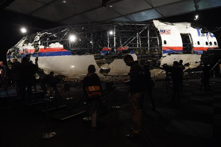 The wrecked cockpit of Malaysia Airlines flight MH17 is presented to the press at the Gilze Rijen airbase on October 13, 2015