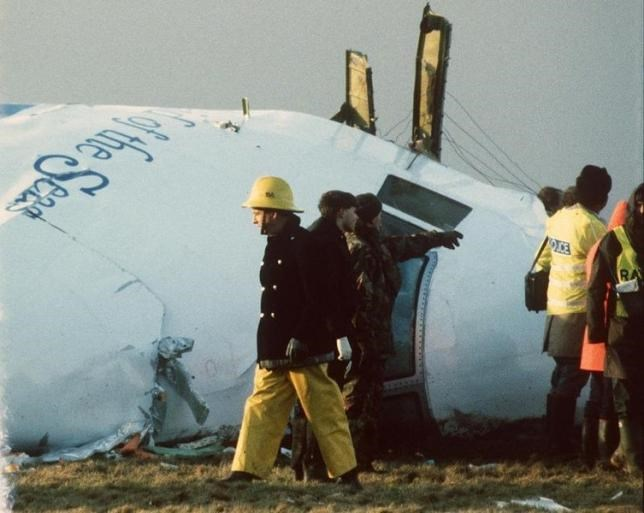 Scottish rescue workers and crash investigators search the area aroundthe cockpit of Pan Am flight 103 in a farmer's field east of LockerbieScotland in this December 23, 1988 file photo.